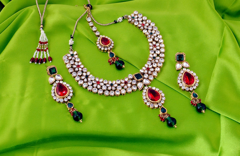 Goldpolish marron, green and white kundan set-9876