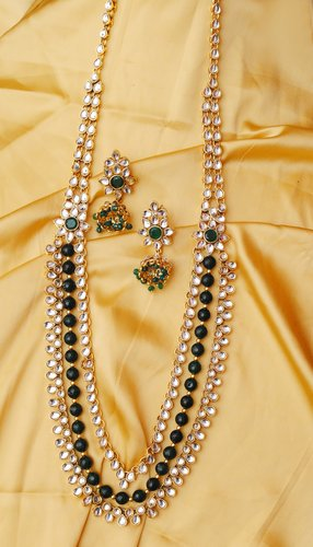 Goldpolish emrald green and white kundan set