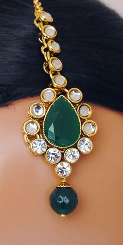 Goldpolish emerald green and white kundan set