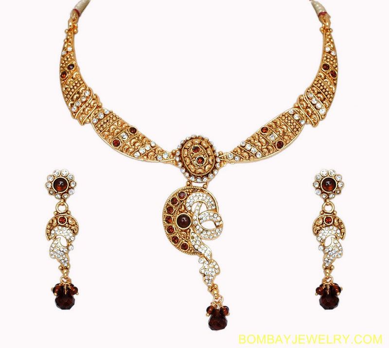 goldplated brown and white polki set