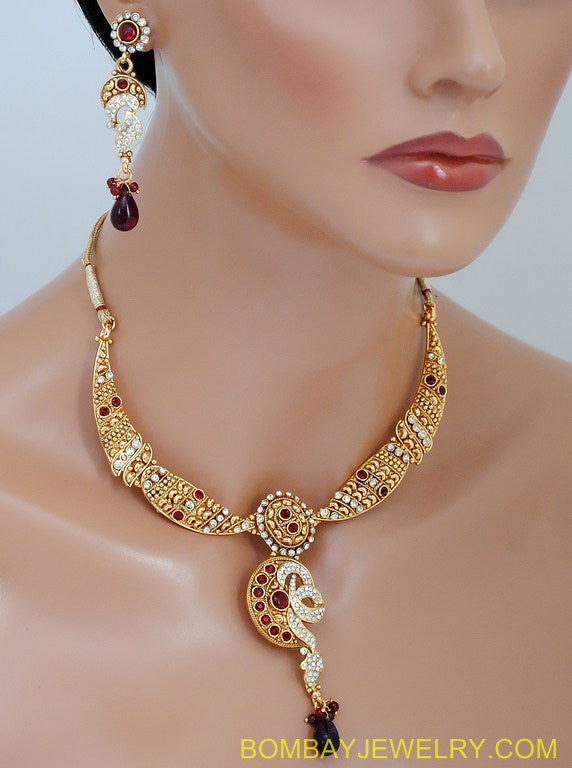 goldplated marron and white polki set with tikka