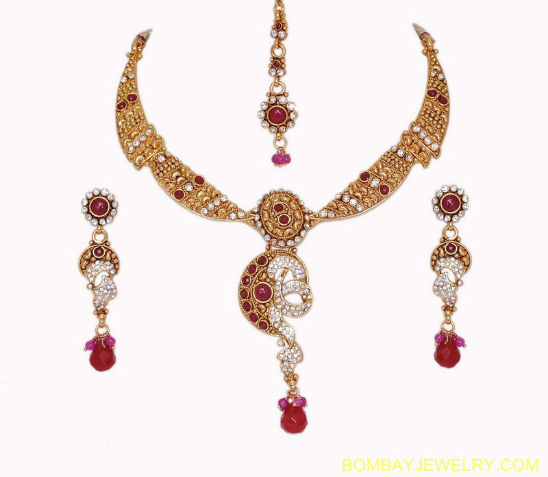 goldplated ruby red and white polki set with tikka