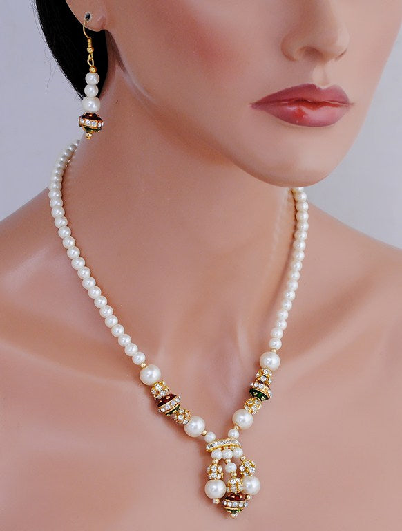goldplated maroon, green and white pearl set