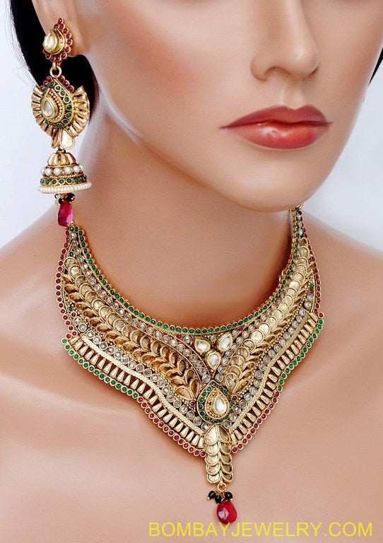 goldplated marron, green and white polki set with tikka