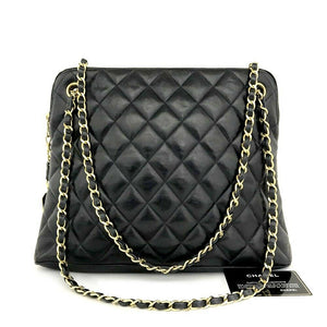 CHANEL Quilted CC Logo Lambskin Trapezoid Bag.