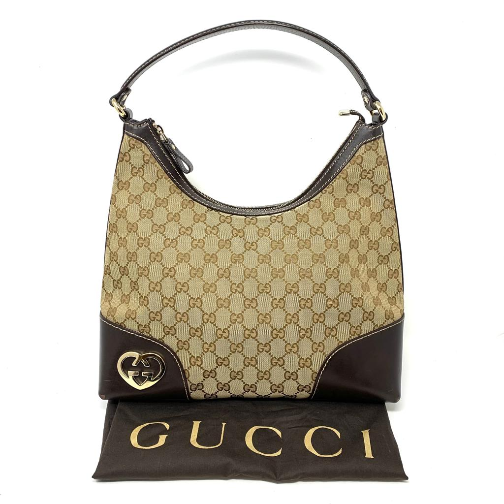 GUCCI GG CANVAS LEATHER HEART INTERLOCKING BAG.