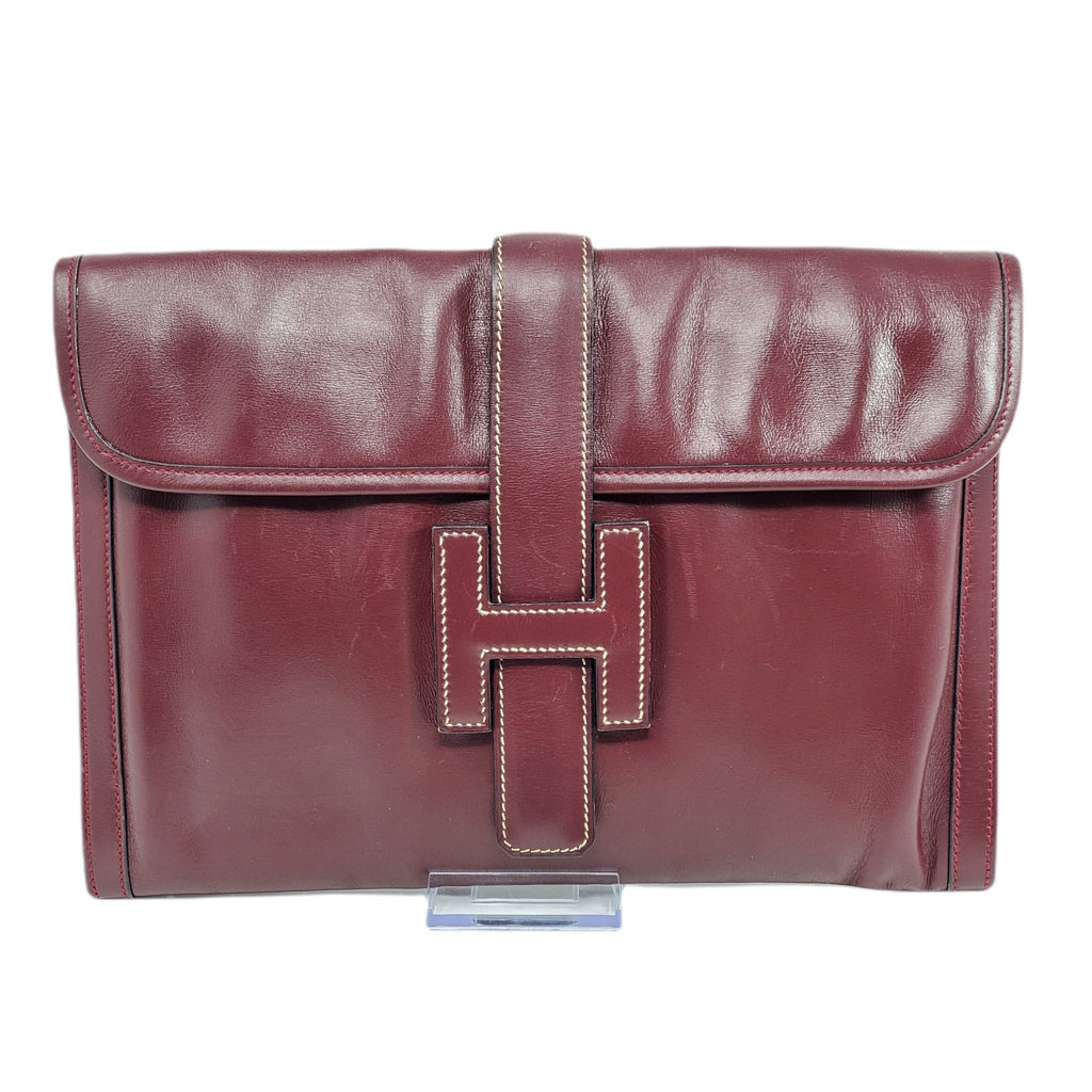 HERMES BORDEAUX LEATHER JIGE CLUTCH BAG.