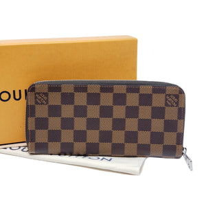 Louis Vuitton Damier Ebene Vertical Zippy Wallet.