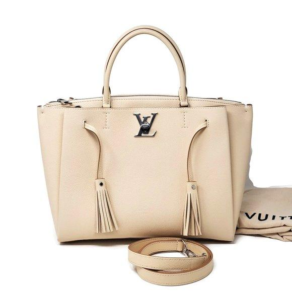 Louis Vuitton Lock Me Beige Leather Tote Bag.