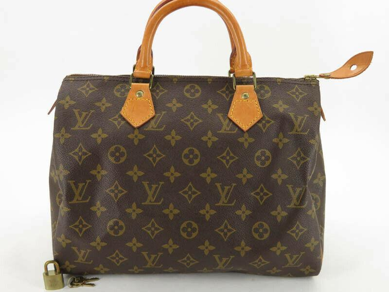 LOUIS VUITTON MONOGRAM SPEEDY 30 HAND BAG.