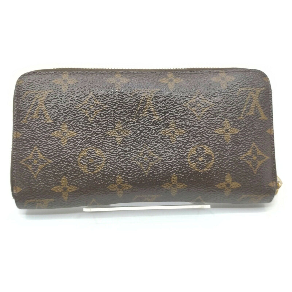 Louis Vuitton Monogram Zippy Wallet.