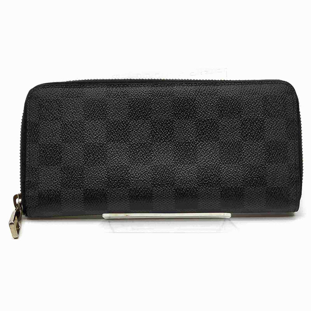 Louis Vuitton Zippy Vertical Round Wallet.