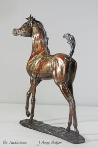 Bronze foal sculpture in contemporary red bronze patina