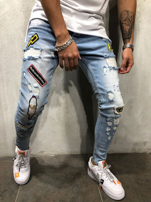Europe and the United States explosions men hip-hop high-end tight slim hole pants new men badge slim jeans