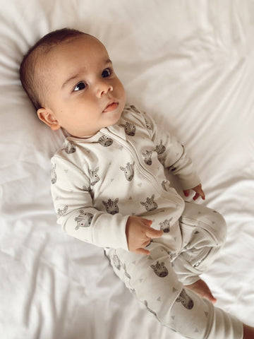 Organic sleepsuit with two way concealed zip from chin to bottom of left leg. Cute zebra face design.