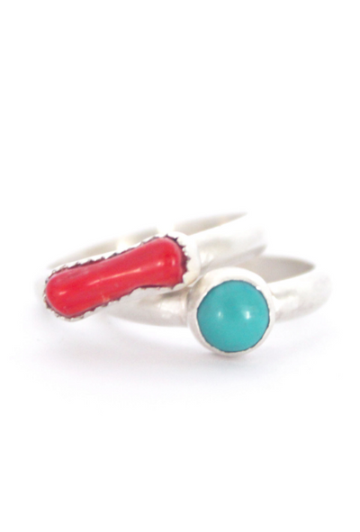 Turquoise and Bamboo Coral Stackers Front View, a set of two rings, one with a round turquoise, the other with a rectangle-shaped piece of red bamboo coral.