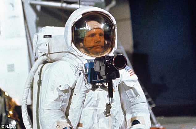 Neil Armstrong with a Hasselblad camera.