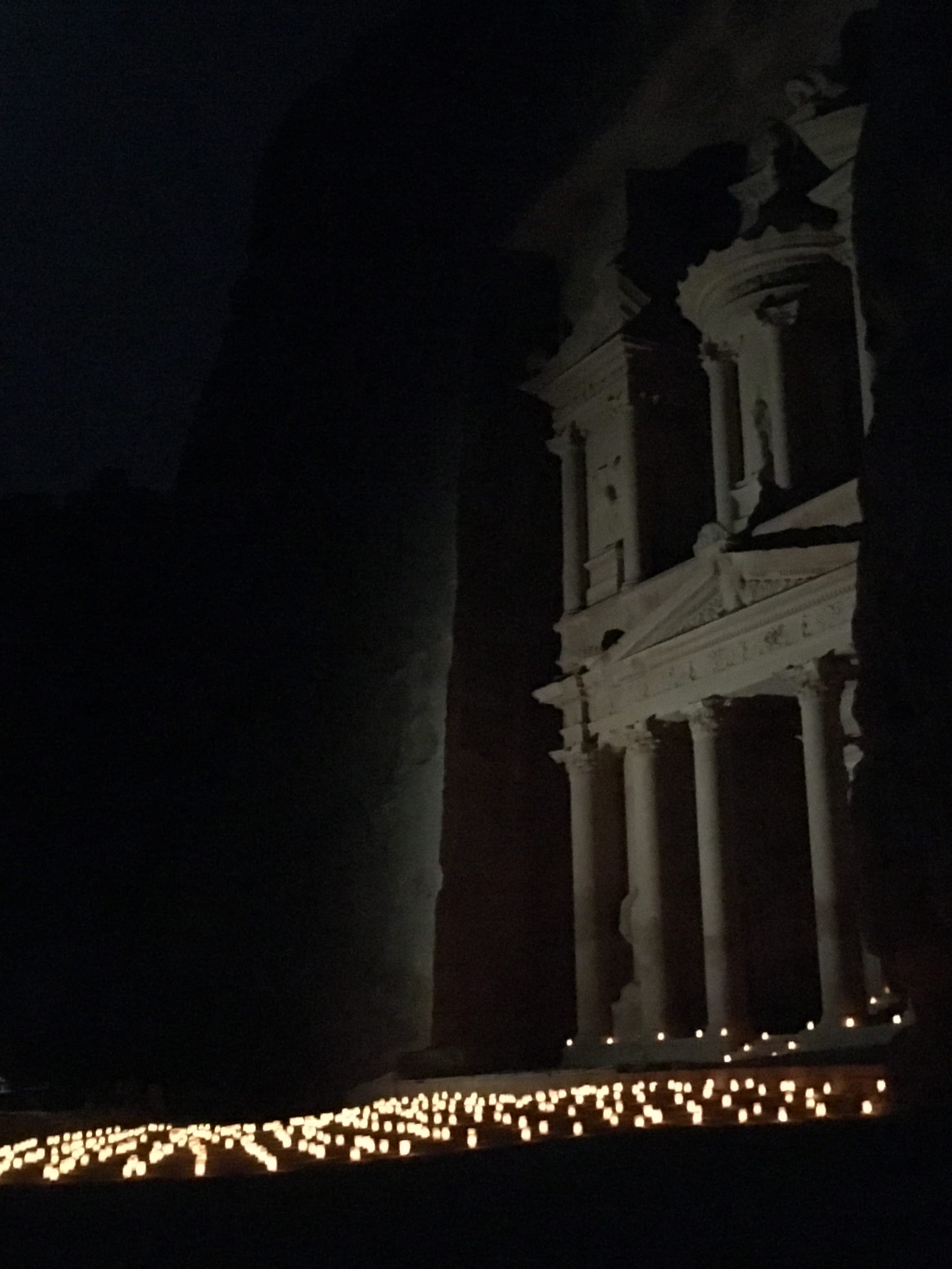 The Treasury at night, lit with hundreds of candles.