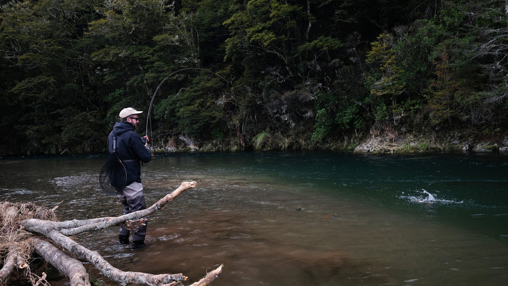 Hooked up to a back country trout in New Zealand