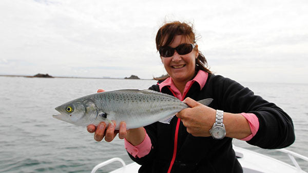 Lady fly fishing guides