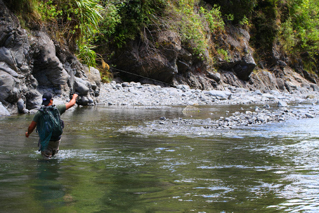 how to play a trout in fast water, fighting fish