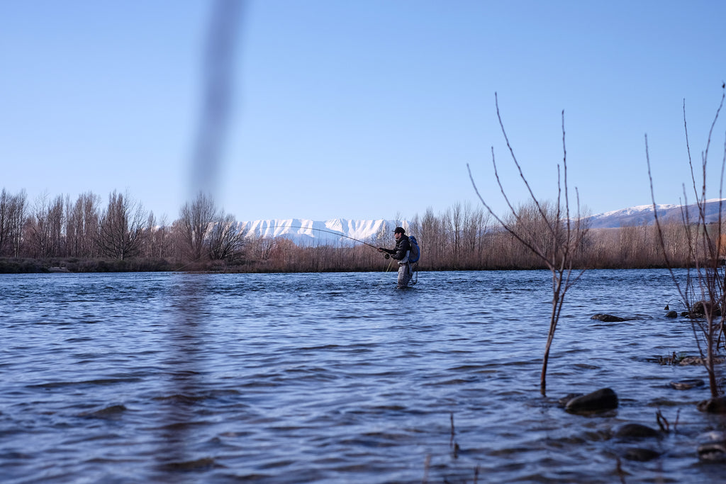 Late winter spey fishing with snow on the hills