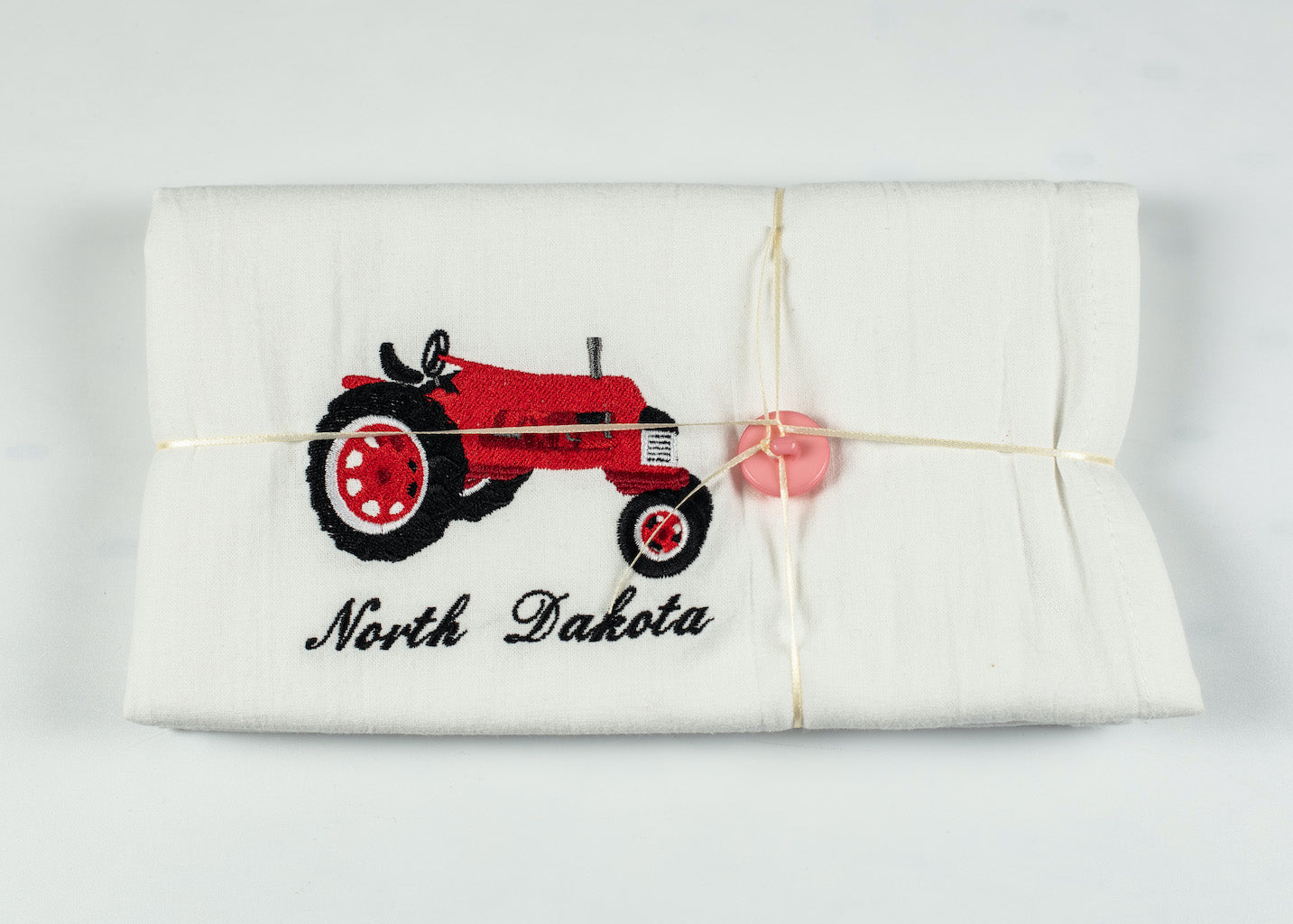 "NORTH DAKOTA EMBROIDERED RED TRACTOR FLOURSACK TOWEL 32"" X 36"" MADE IN ST. BONIFACIUS MN"