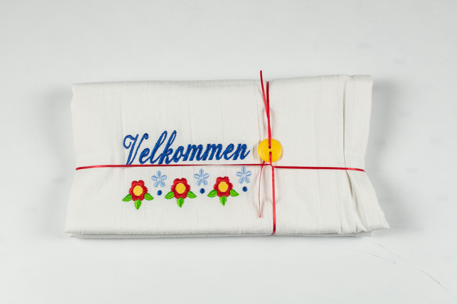 "VELKOMMEN EMBROIDERED FLOURSACK TOWEL 32"" X 36"" MADE IN ST. BONIFACIUS MN"