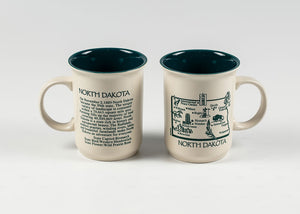 11 OZ WRAP DESIGN NORTH DAKOTA HISTORY MUG CREAM COLOR MUG WITH GREEN IMPRINT