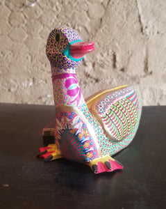 Carved colorful duck by Maria Jimenez Ojada