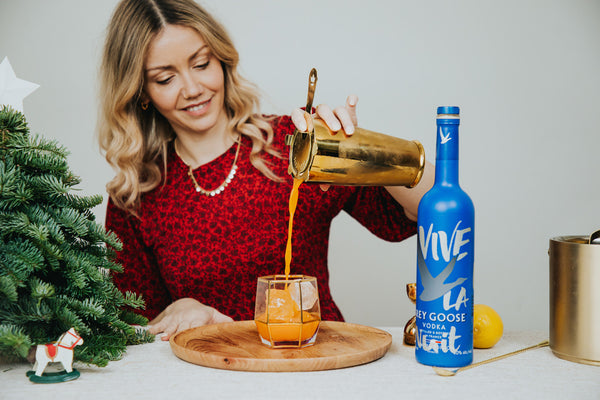 Camille pouring a Grey Goose cocktail
