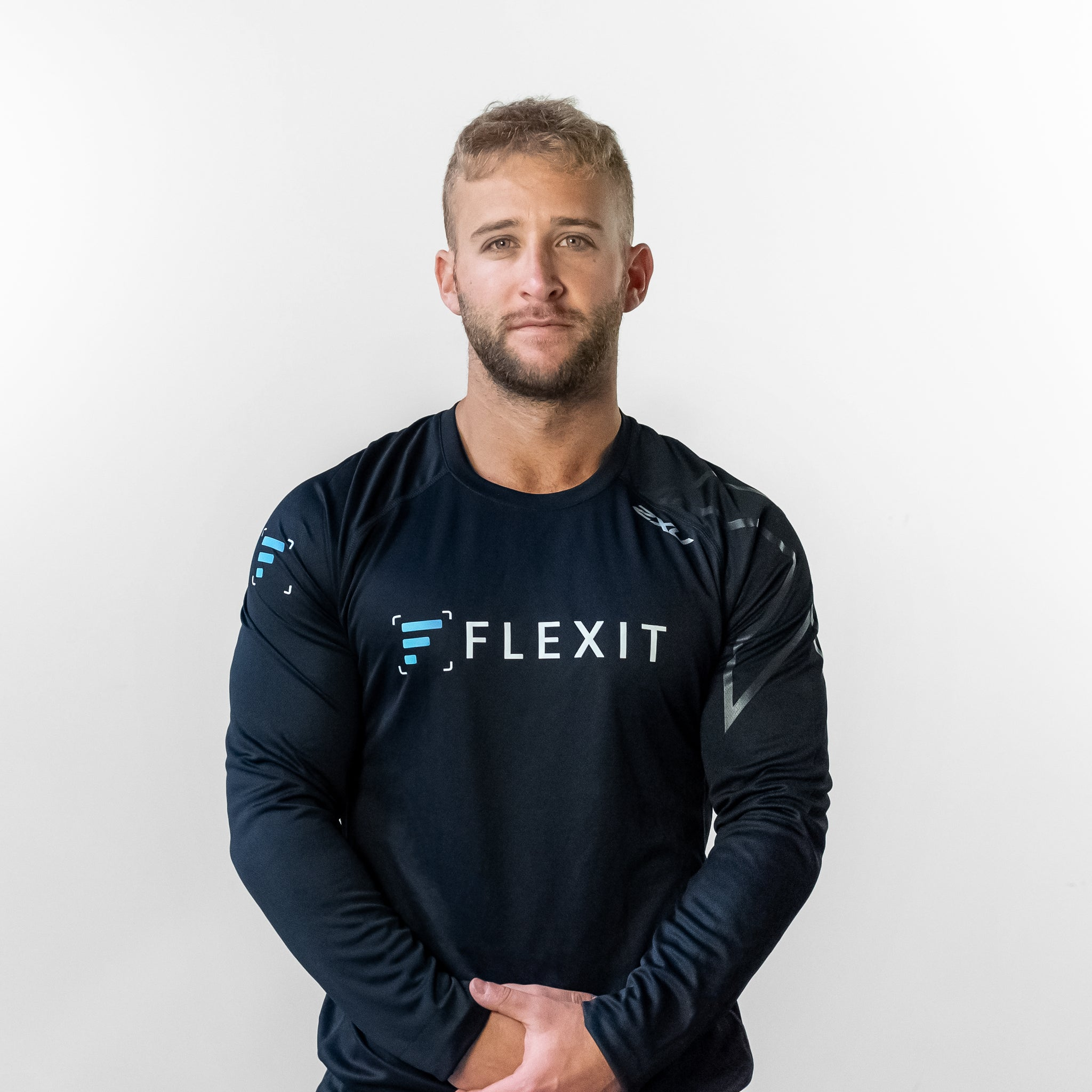 Man wearing FlexIt Dry Fit black long sleeve shirt.