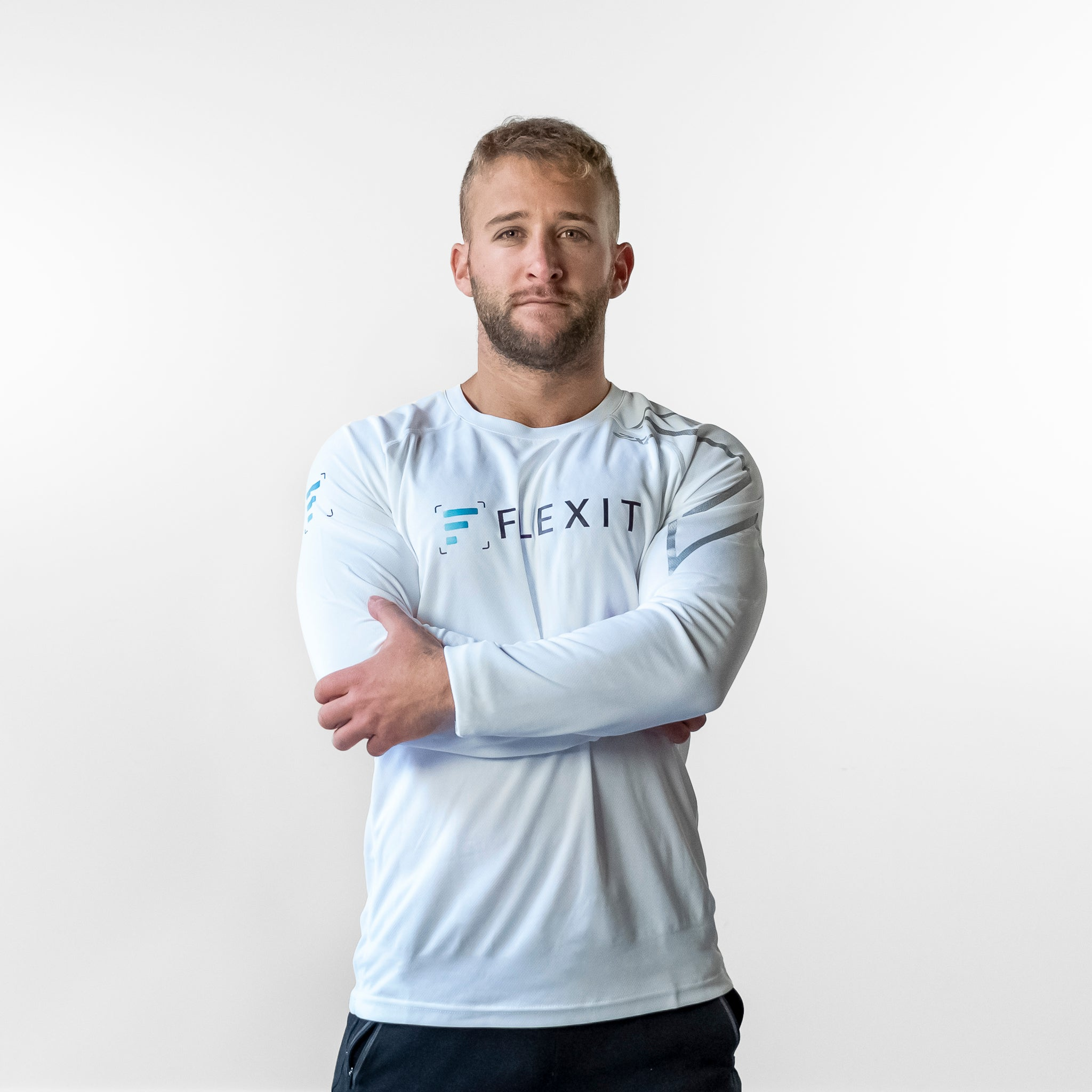Man wearing FlexIt Dry Fit white long sleeve shirt.
