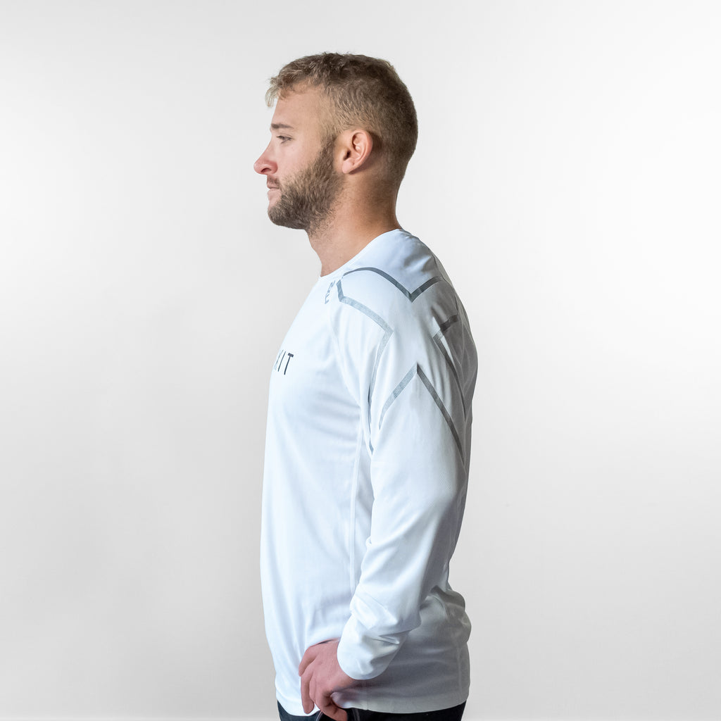 Side angle of man wearing FlexIt Dry Fit white long sleeve shirt.