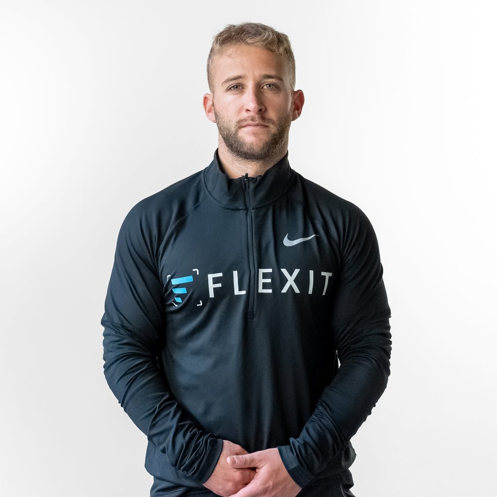 Man wearing FlexIt Stretch Quarter Zip.