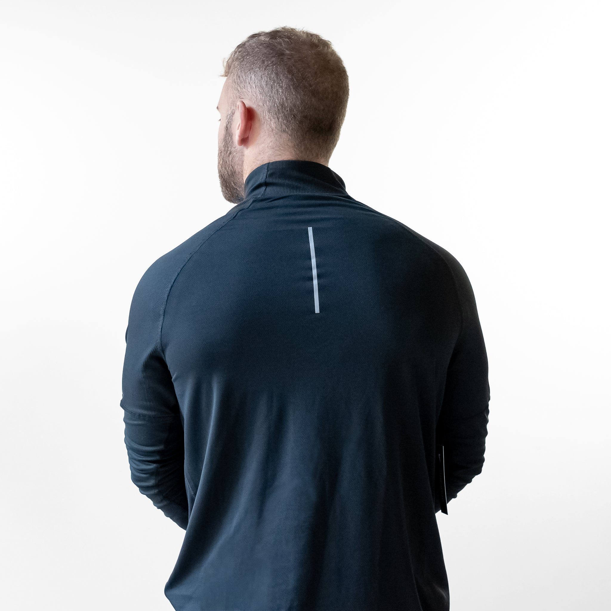 Back angle of man wearing FlexIt Stretch Quarter Zip.