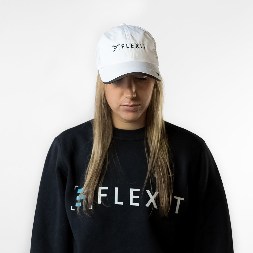 Woman wearing with FlexIt white hat with black bill.