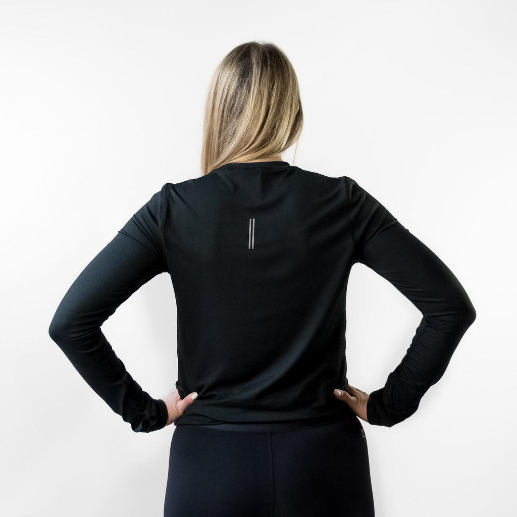 Back angle of woman in FlexIt long sleeve shirt.
