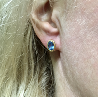 Yellow Gold and Blue Topaz Oval Stud Earrings