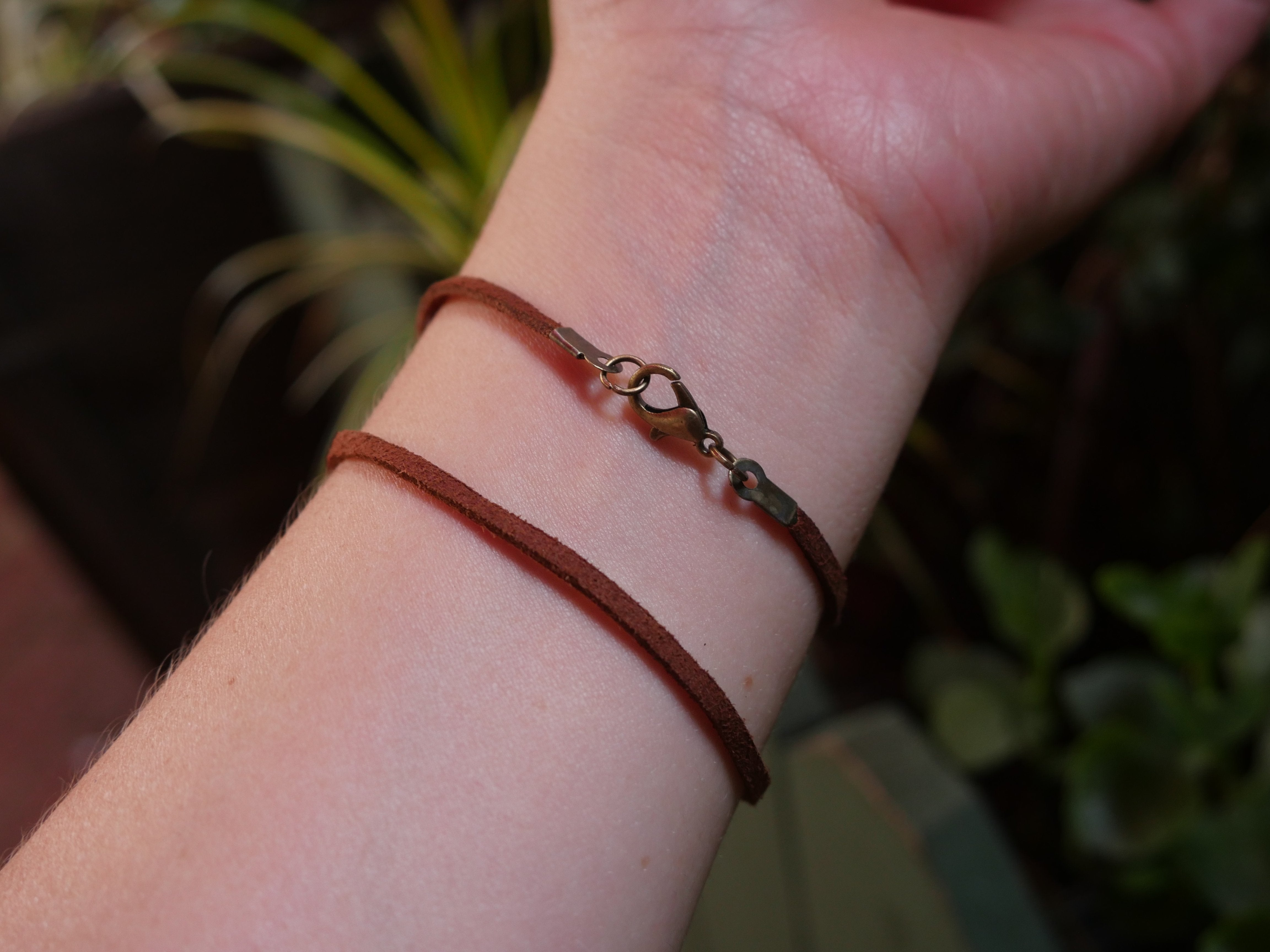 Brown and grey concentric circle stone double loop brown bracelet