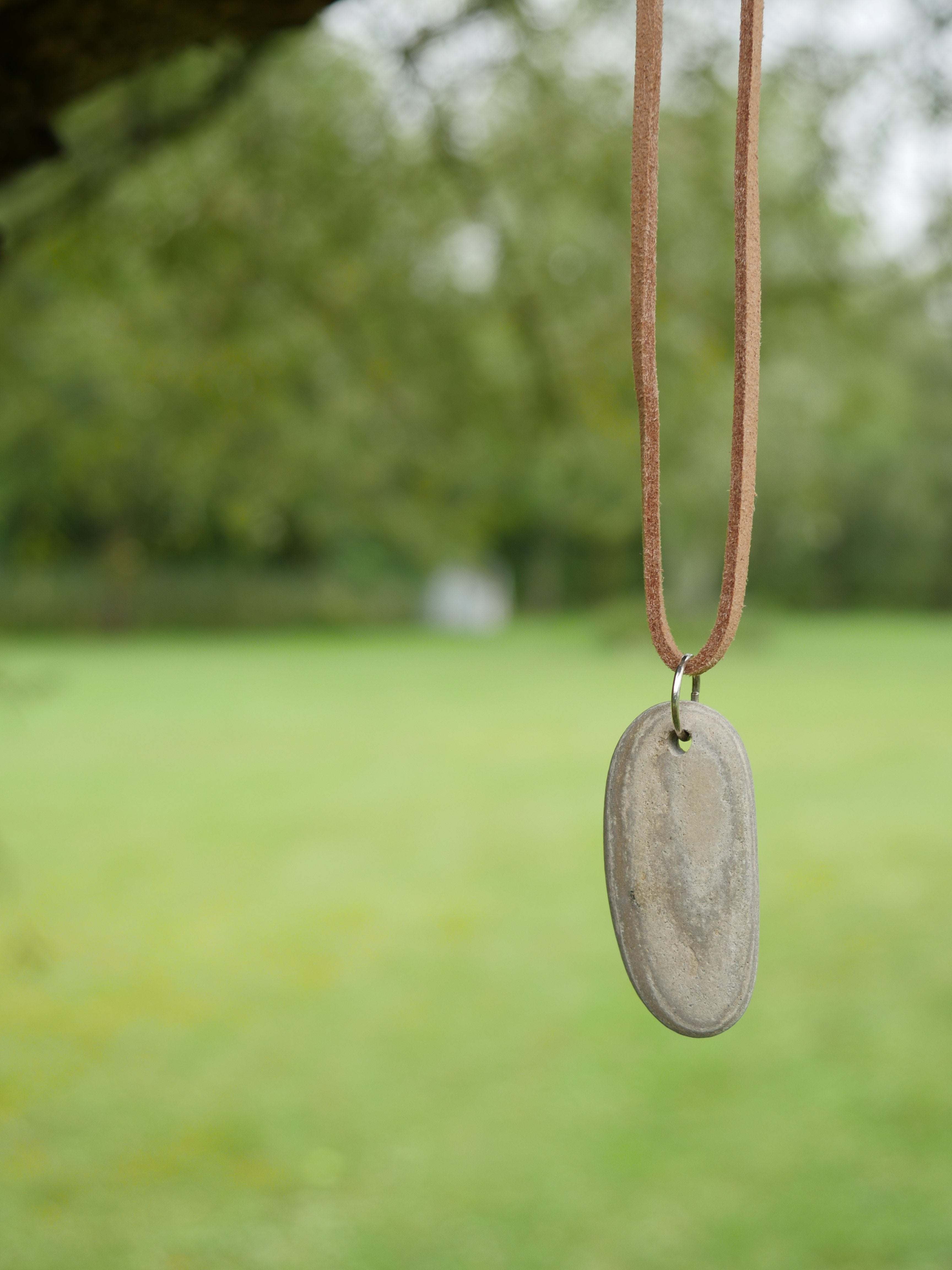 Grey white stone light brown suede necklace