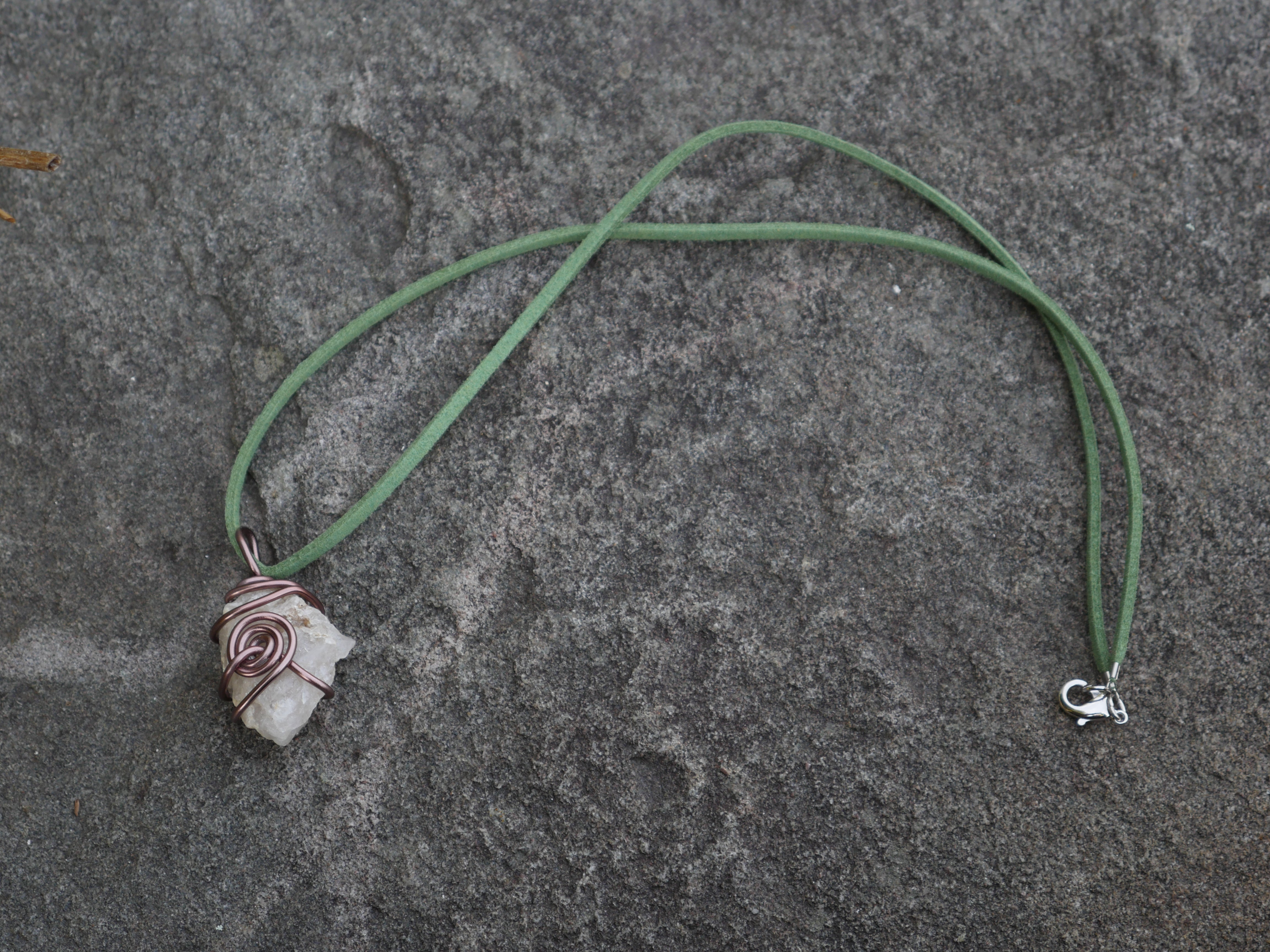 Mauve wire wrapped white stone green suede necklace