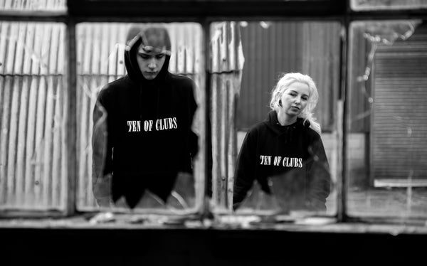 Man and woman in Wave Hoodies from Ten of Clubs