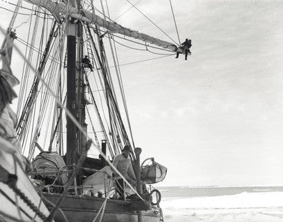 Frank Hurley aloft, Ernest Shackleton on the deck of the Endurance
