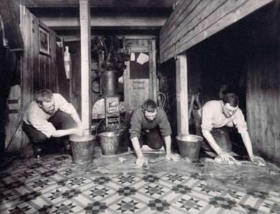 Wordie, Cheetham and Macklin washing the galley floor of the Endurance