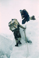 Hillary assisting Sherpas with supply loads in the icefall