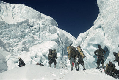 Sherpas with loads in the icefall