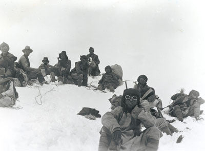 Team members including Mallory and Sherpas at a rest stop on Everest