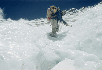 Tenzing wearing crampons climbing down an icy patch on the Lhotse Face
