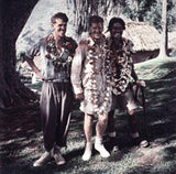 Hillary, Hunt and Tenzing Norgay wearing garlands of flowers